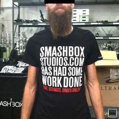 Hire Dee deLara - Portfolio - Smashbox Studios Website Announcement T-Shirt